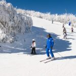 Enjoying a kids lesson at Ski School