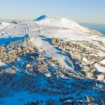 A view of the beautiful Mt Buller Village and all the way up to the summit at 1805m